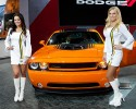 Models pose next to a limited-edition Dodge Challenger Hemi Shaker, Monday, Jan. 13, 2014, at the North American International Auto Show in Detroit, Mich.