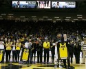 Iowa guard Devyn Marble stands with Iowa head coach Fran McCaffery, right, during senior day ceremonies before an NCAA college basketball game against Iowa, Saturday, March 8, 2014, in Iowa City, Iowa.