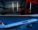 Members of the social group Christian Muslim Alliance Pakistan take part in a candlelight vigil for passengers that were aboard a missing Malaysia Airlines plane, Tuesday, March 18, 2014 in Islamabad, Pakistan. The search for Malaysian Flight 370, which vanished early March 8, 2014 while flying from Kuala Lumpur to Beijing with 239 people on board, has now been expanded deep into the northern and southern hemispheres.