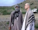 In this image taken from video obtained from Voice Of Jihad Website, which has been authenticated based on its contents and other AP reporting, Sgt. Bowe Bergdahl, right, stands with a Taliban fighter in eastern Afghanistan. The Taliban on Wednesday, June 4, 2014, released a video showing the handover of Bergdahl to U.S. forces in eastern Afghanistan, touting the swap of the American soldier for five Taliban detainees from Guantanamo as a significant achievement for the insurgents. Bergdahl was freed on Saturday after five years in captivity, and exchanged for the five Guantanamo detainees who were flown to Qatar, a tiny Gulf Arab country which has served as a mediator in the negotiations for the swap.