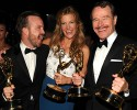 IMAGE DISTRIBUTED FOR THE TELEVISION ACADEMY - EXCLUSIVE - Aaron Paul, from left, Anna Gunn and Bryan Cranston attend the Governors Ball at the 66th Primetime Emmy Awards at the Nokia Theatre L.A. Live on Monday, Aug. 25, 2014, in Los Angeles.