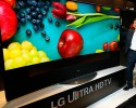 IMAGE DISTRIBUTED FOR LG ELECTRONICS - William Cho, president of LG Electronics USA, unveils LG's 105-inch Ultra HD 4K TV (model 105UC9) at the CEDIA Expo 2014, on Thursday, Sept. 11, 2014, in Denver.