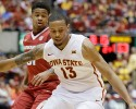 Iowa State guard Bryce Dejean-Jones (13) chases a loose ball ahead of Arkansas guard Anton Beard, rear, during the second half of an NCAA college basketball game, Thursday, Dec. 4, 2014, in Ames, Iowa.