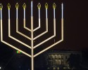 The White House is in the background after the national menorah was lit during a ceremony marking the start of the celebration of Hanukkah, on the Ellipse near the White House in Washington, Tuesday, Dec. 16, 2014.