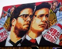 "A banner for ""The Interview""is posted outside Arclight Cinemas, Wednesday, Dec. 17, 2014, in the Hollywood section of Los Angeles. A U.S. official says North Korea perpetrated the unprecedented act of cyberwarfare against Sony Pictures that exposed tens of thousands of sensitive documents and escalated to threats of terrorist attacks that ultimately drove the studio to cancel all release plans for ""The Interview."""