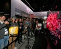 "IMAGE DISTRIBUTED FOR LG - TV lovers fawn over the LG 77"" Flexible 4K ULTRA HD OLED TV at the 2015 International CES on Tuesday, Jan. 6, 2015, in Las Vegas."