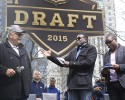 Chicago Bears legend Dick Butkus, left, is interviewed by Michael Irvin, center, and Cris Carter during introductions at a pre-draft rally of 2015 NFL Draft prospects, and various league legends at Pioneer Court, Wednesday, April 29, 2015, in Chicago.